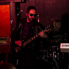 Simon on Gibson guitar with Denzeity at the RockSteady in Dalston