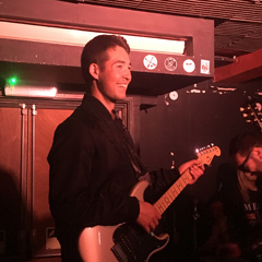 Tom playing and smiling at the RockSteady in Dalston